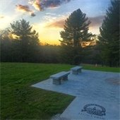 sunset behind two park benches