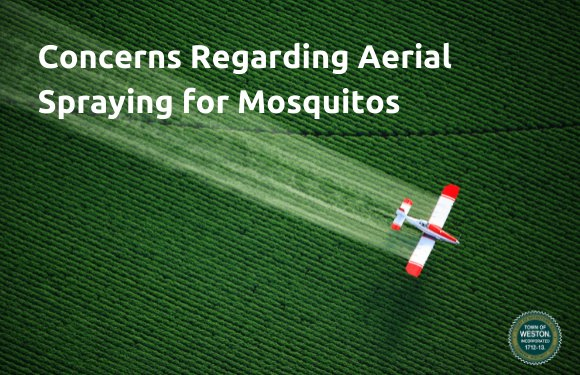 aerial spraying over green field