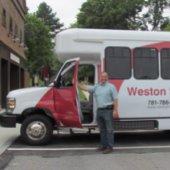 Weston shuttle with driver holding door open