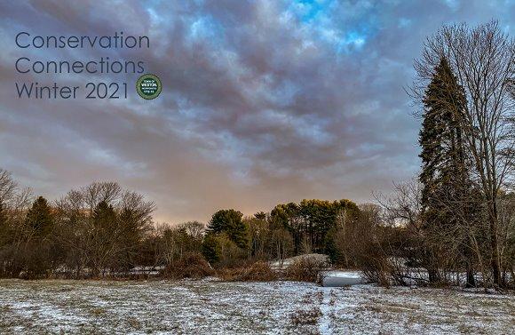 winter sunset over snowy field