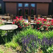 flowers and chairs on patio at Community Center