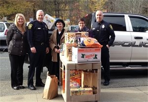 Weston Police deliver Thanksgiving donations to the Food Pantry.