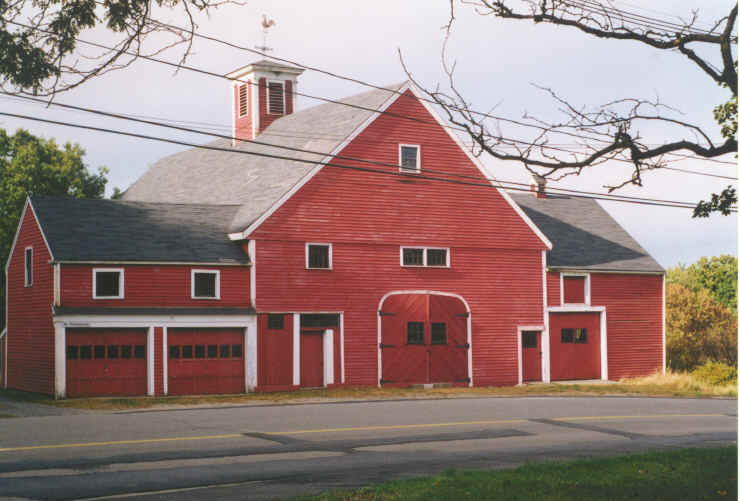 A large red house with barn doors