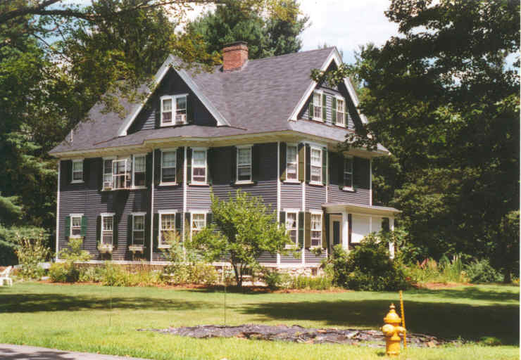 A large house with dark gray clapboards