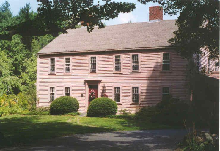 A colonial style house with an offset chimney