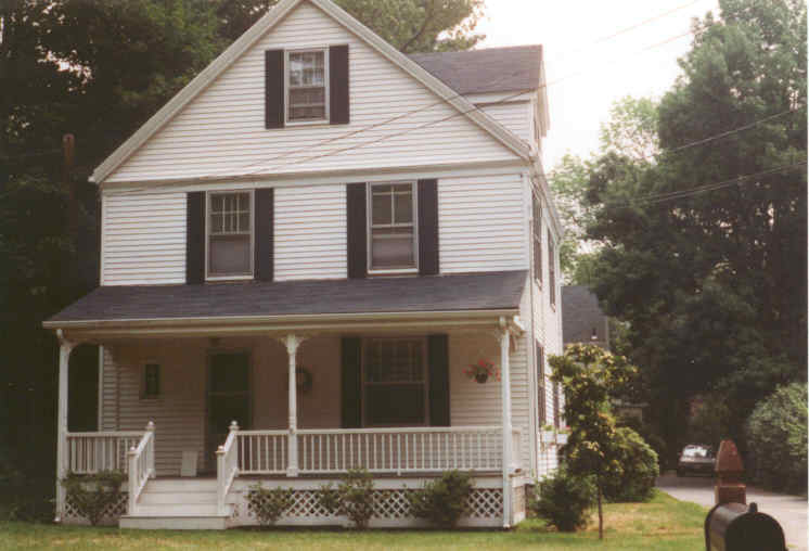 A white house with a front porch and clapboards