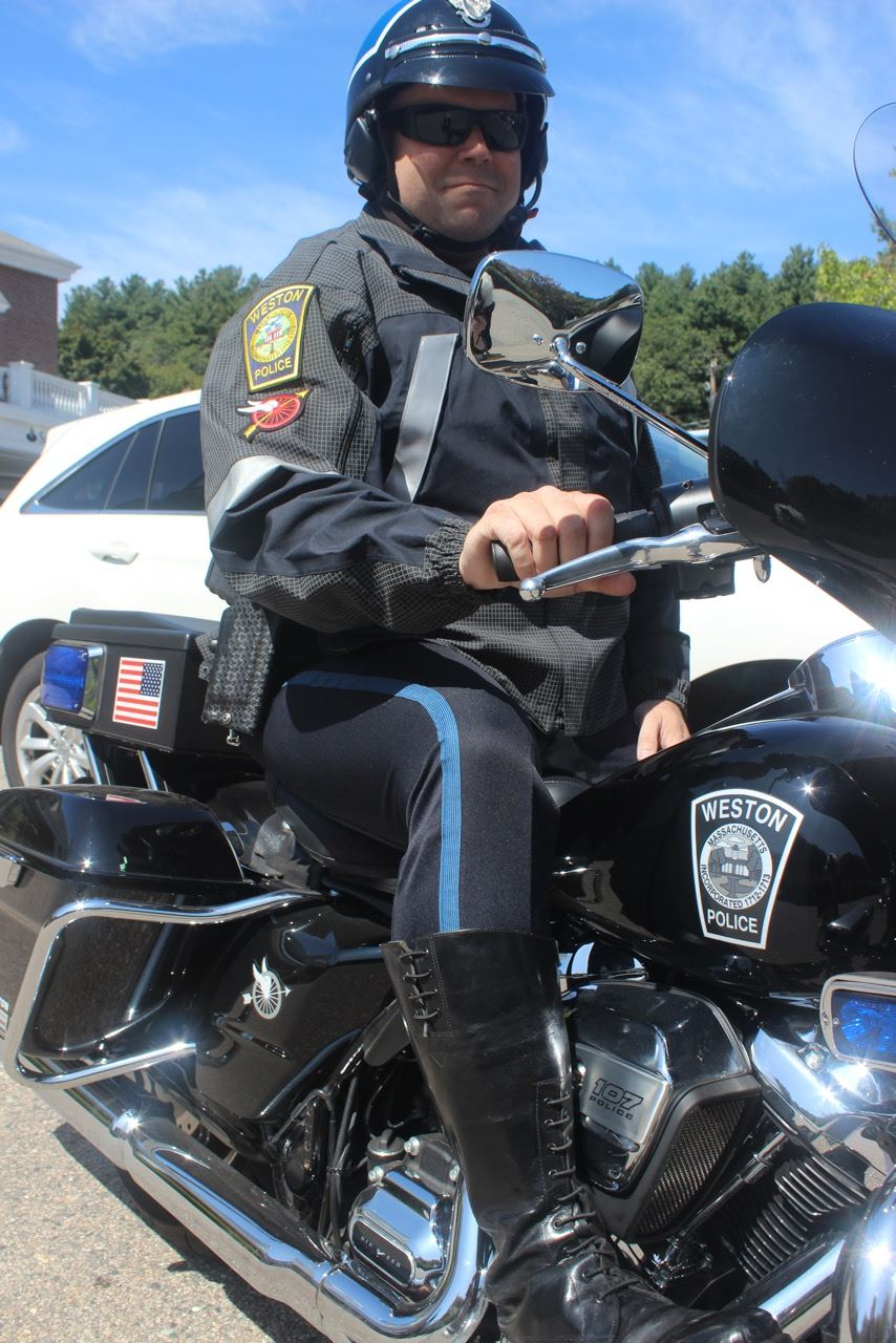 Officer Porzio on the department's motorcycle