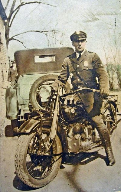 early photo of weston officer Maurice Upham on vintage harley davidson