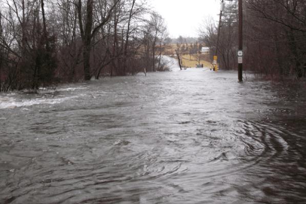 flooding over a bridge
