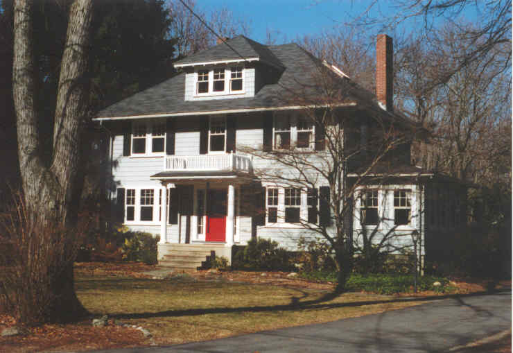 A Colonial Revival style house with a red door